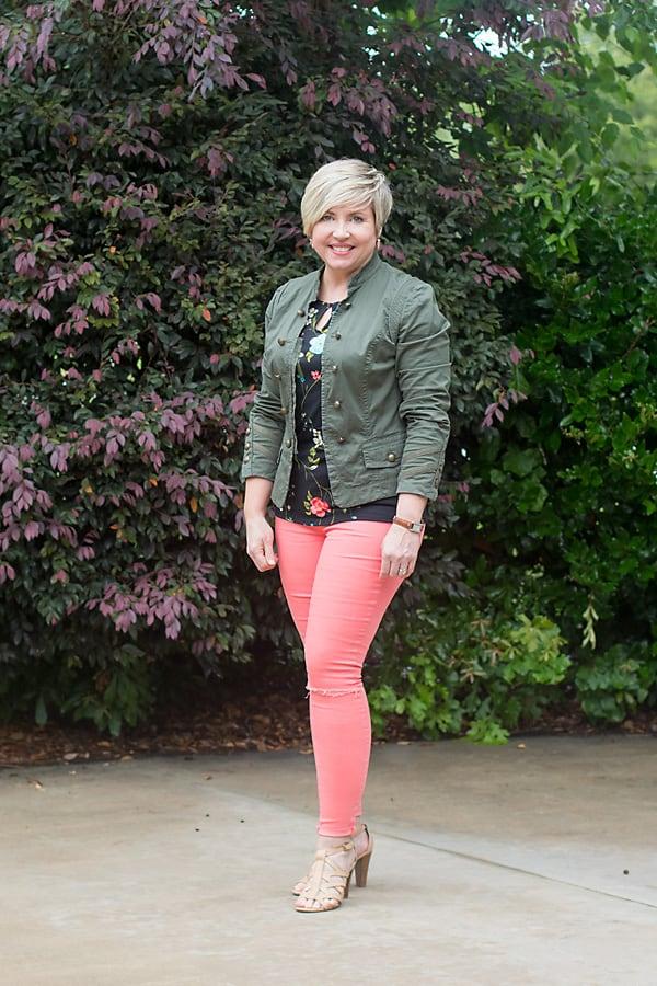 coral jeans, black floral top
