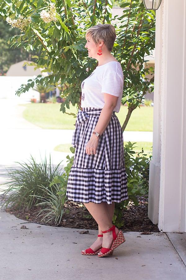 gingham skirt, red statement earrings, bright sandals, gingham
