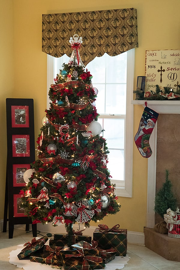 Christmas tree with red plaid ribbon and white crochet ornaments