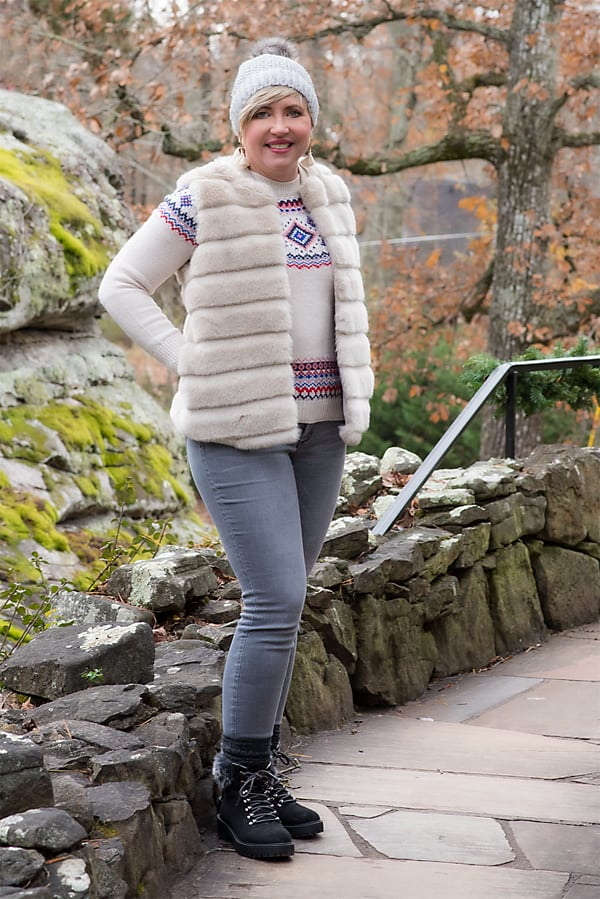 Fashion blogger Savvy Southern Chic in faux fur vest and fair isle sweater