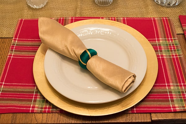 Plaid placement with gold napkin and gold charger