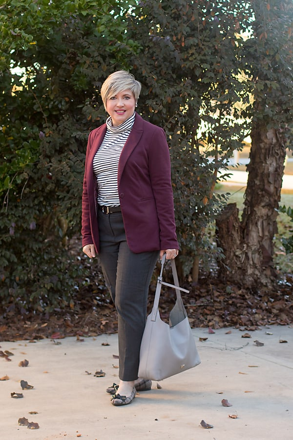 Fashion blogger Savvy Southern Chic is JCrew turtleneck tee.