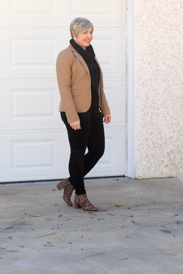 black cowl neck sweater with camel blazer and black velvet pants