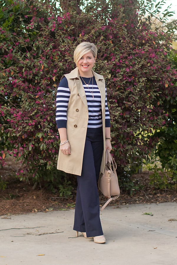 fashion blogger in sleeveless trench coat
