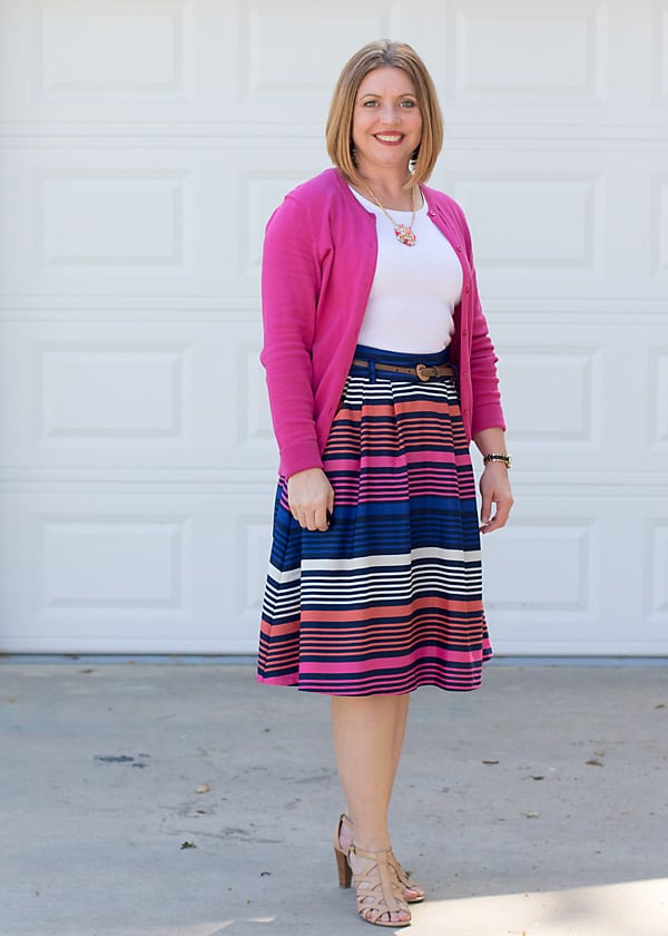 Hot pink cardigan with striped skirt, spring outfit