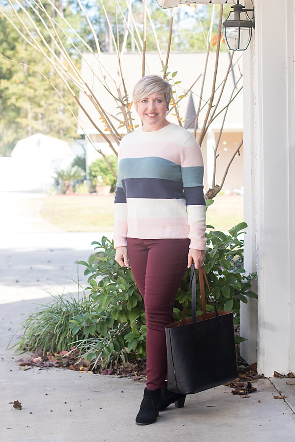 winter outfit with stripe sweater and burgundy jeans