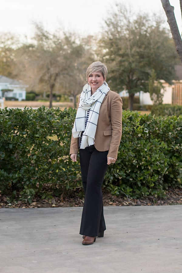 camel blazer with plaid scarf and striped top/ black trousers and booties