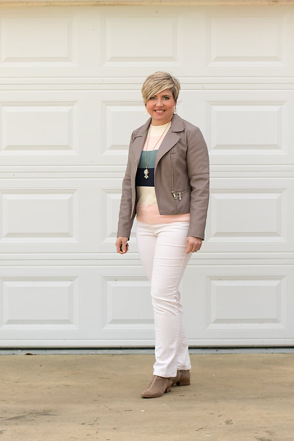 color block sweater with corduroy jeans and moto jacket
