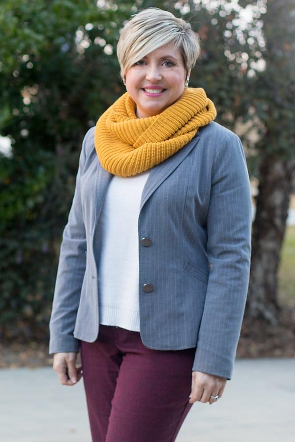 mustard infinity scarf with grey blazer