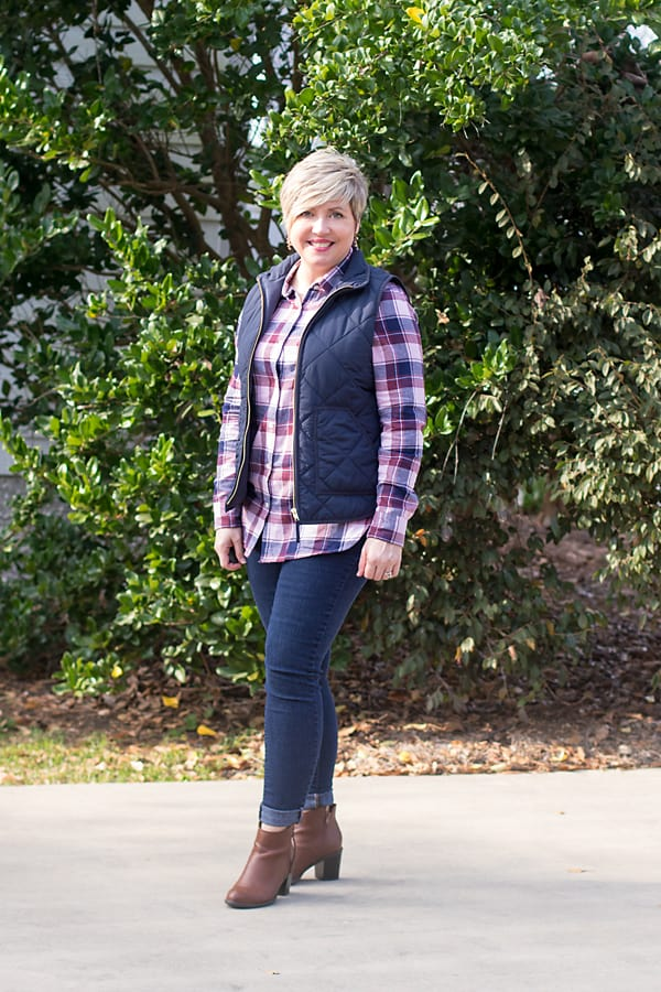 plaid shirt with navy puffer vest, denim leggings and ankle boots