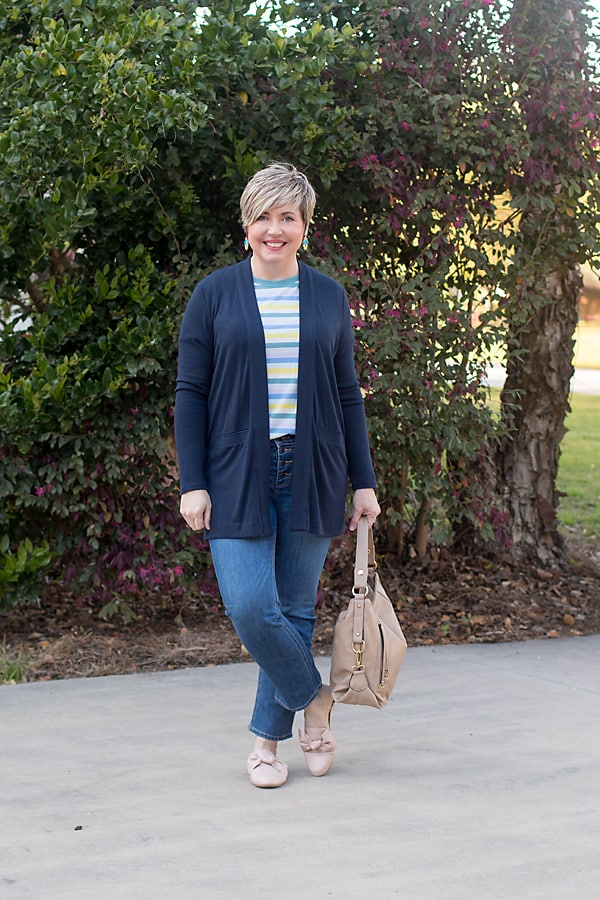 striped tee with navy cardigan and button fly jeans