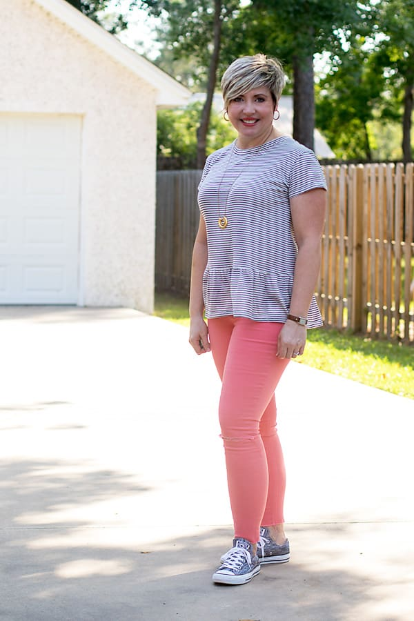 grey sneakers with coral jeans