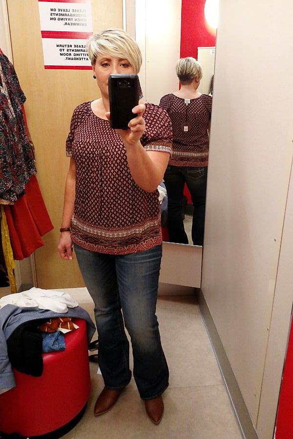 warm fall colors top and boot cut jeans