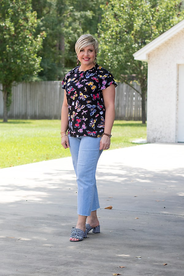 fashion blogger in gingham mules and butterfly print top