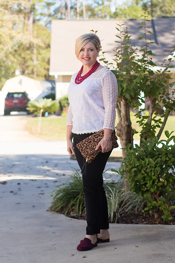19 Christmas outfits that aren't red and black for women over 40/ lace top and velvet pants