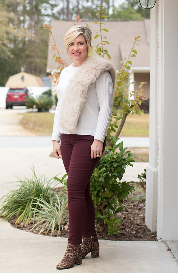 holiday party outfit with faux fur scarf and leopard boots