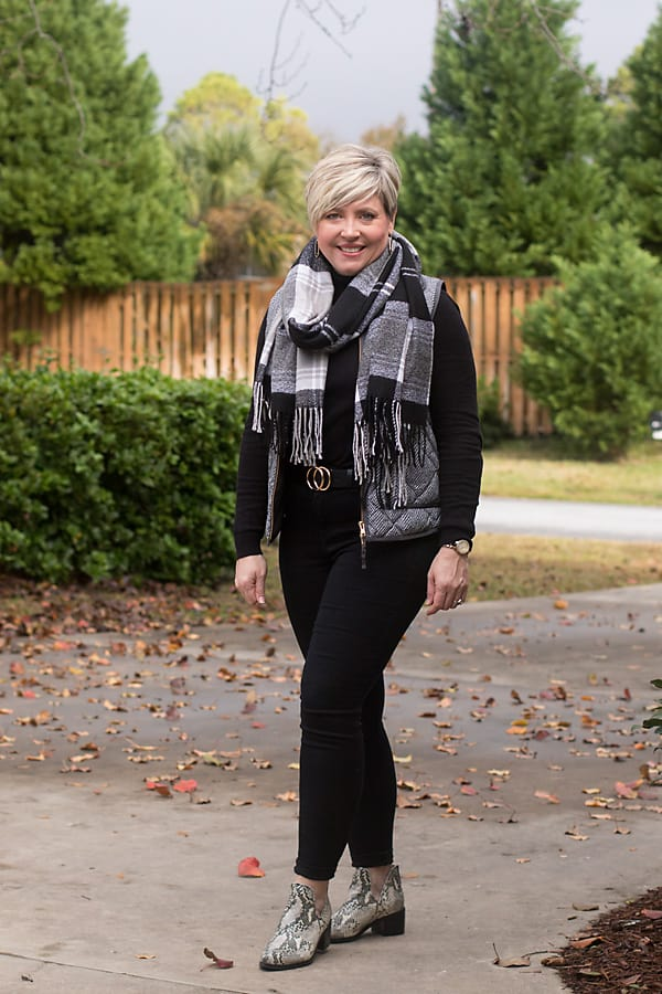black jeans and herringbone vest outfit