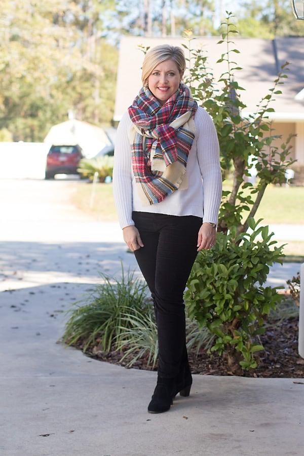 Plaid scarf and cream sweater