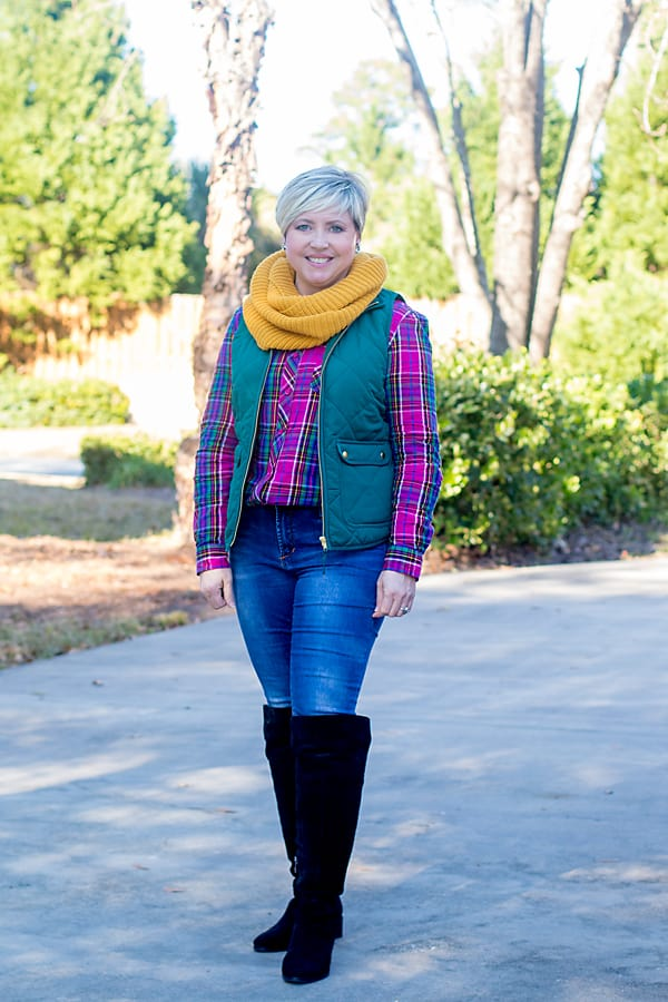 bright vest and plaid flannel