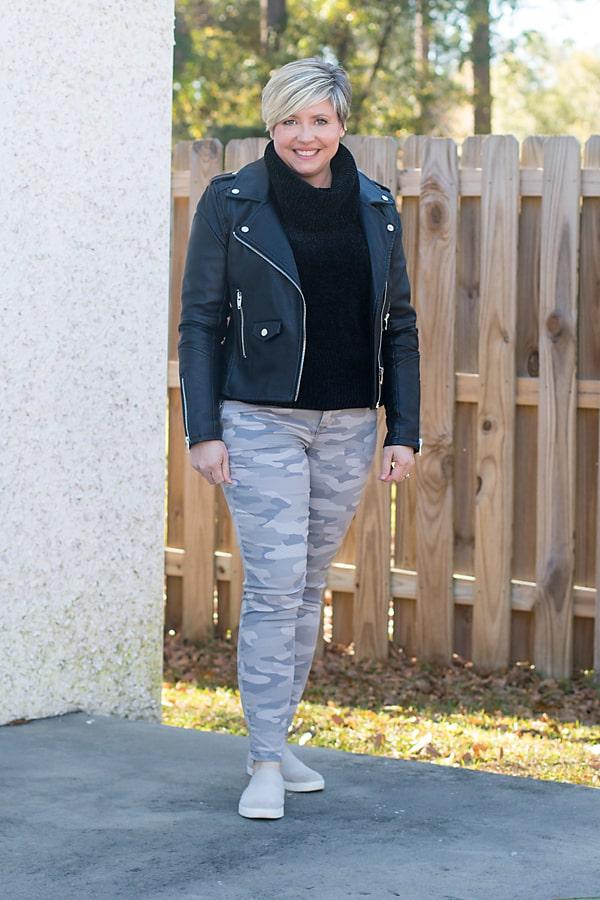 camo pants and black turtleneck