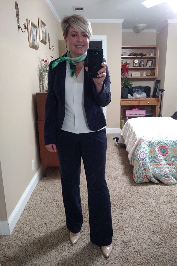 navy suit with white top and green scarf