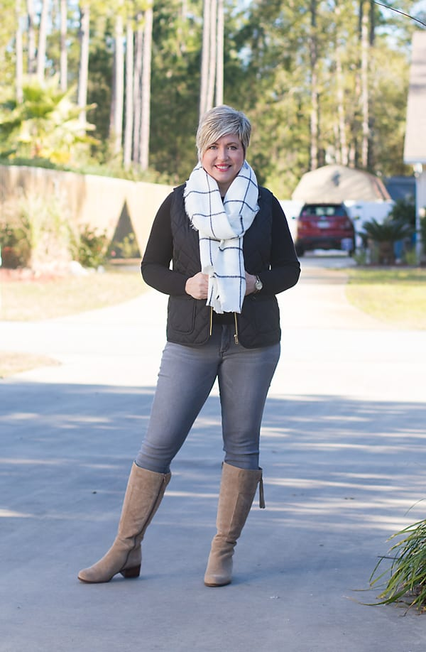 grey jeans with black quilted vest