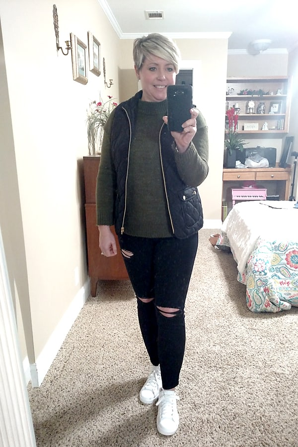 quilted vest and distressed jeans
