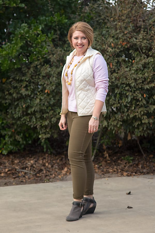 quilted vest with olive jeans