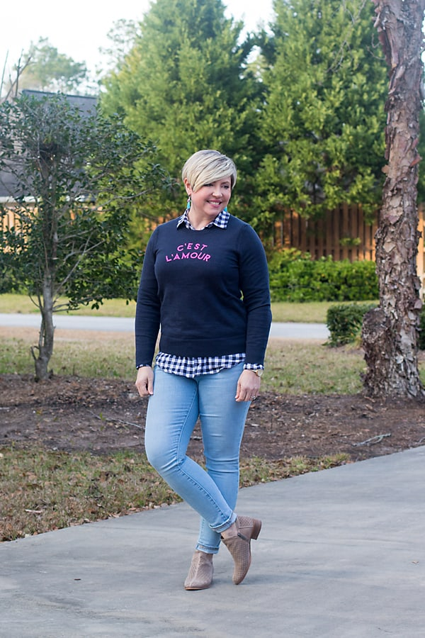 graphic sweater with gingham shirt