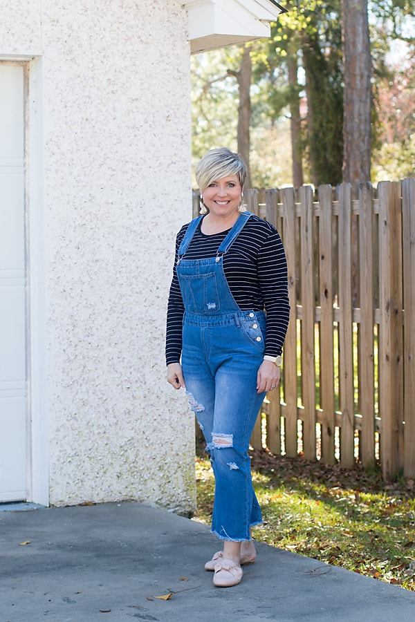 distressed overalls with striped tee