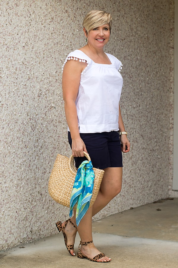 elevated basic white top with navy shorts