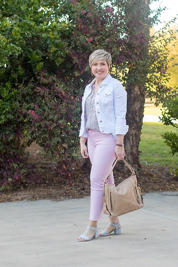 white denim jacket with pastel jeans