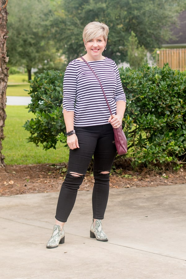 outfit formula black jeans striped top snakeskin boots