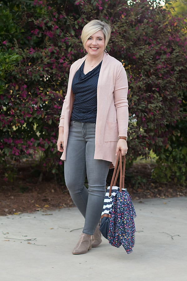 grey jeans with pink cardigan and taupe boots