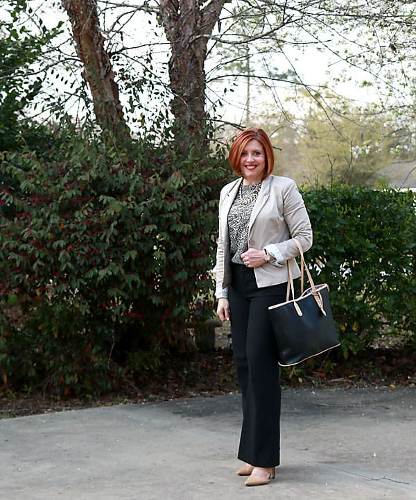 neutral work outfit with animal print top