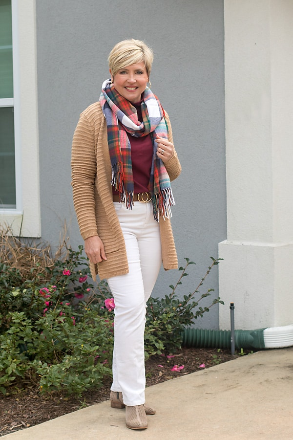 women's winter outfit with corduroy pants and plaid scarf
