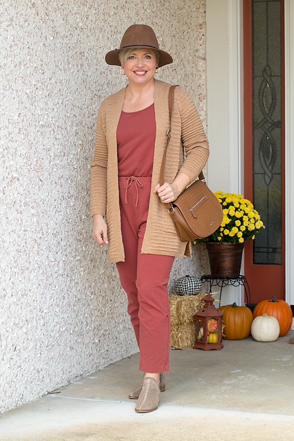 jumpsuit with cardigan and fall hat outfit idea