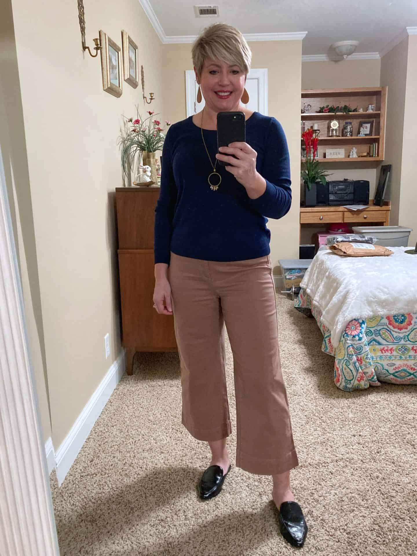 sweater with wide leg crop pants and mule loafers outfit