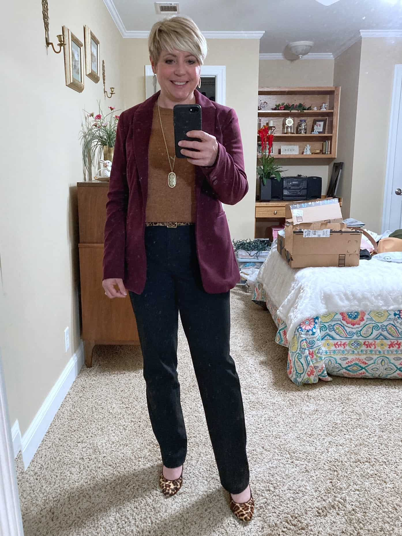 womens office outfit with burgundy blazer and camel sweater