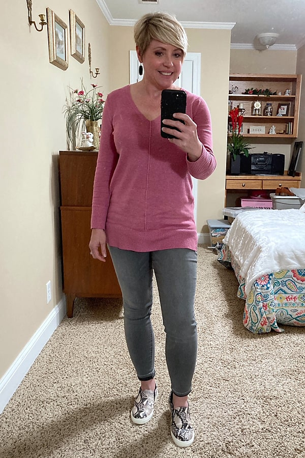 tunic sweater and jeans with snakeskin sneakers comfy outfit