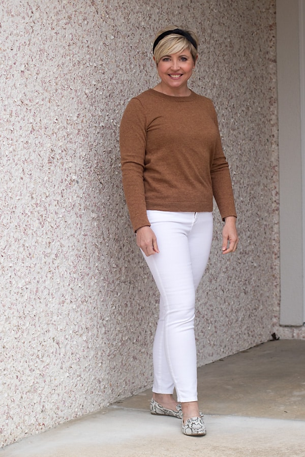white jeans and camel sweater winter neutral outfit