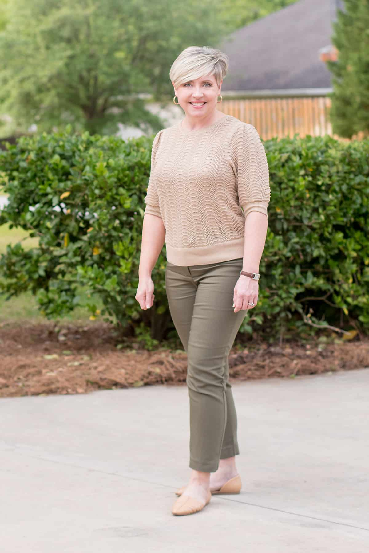 spring office outfit for women with olive pants and beige sweater