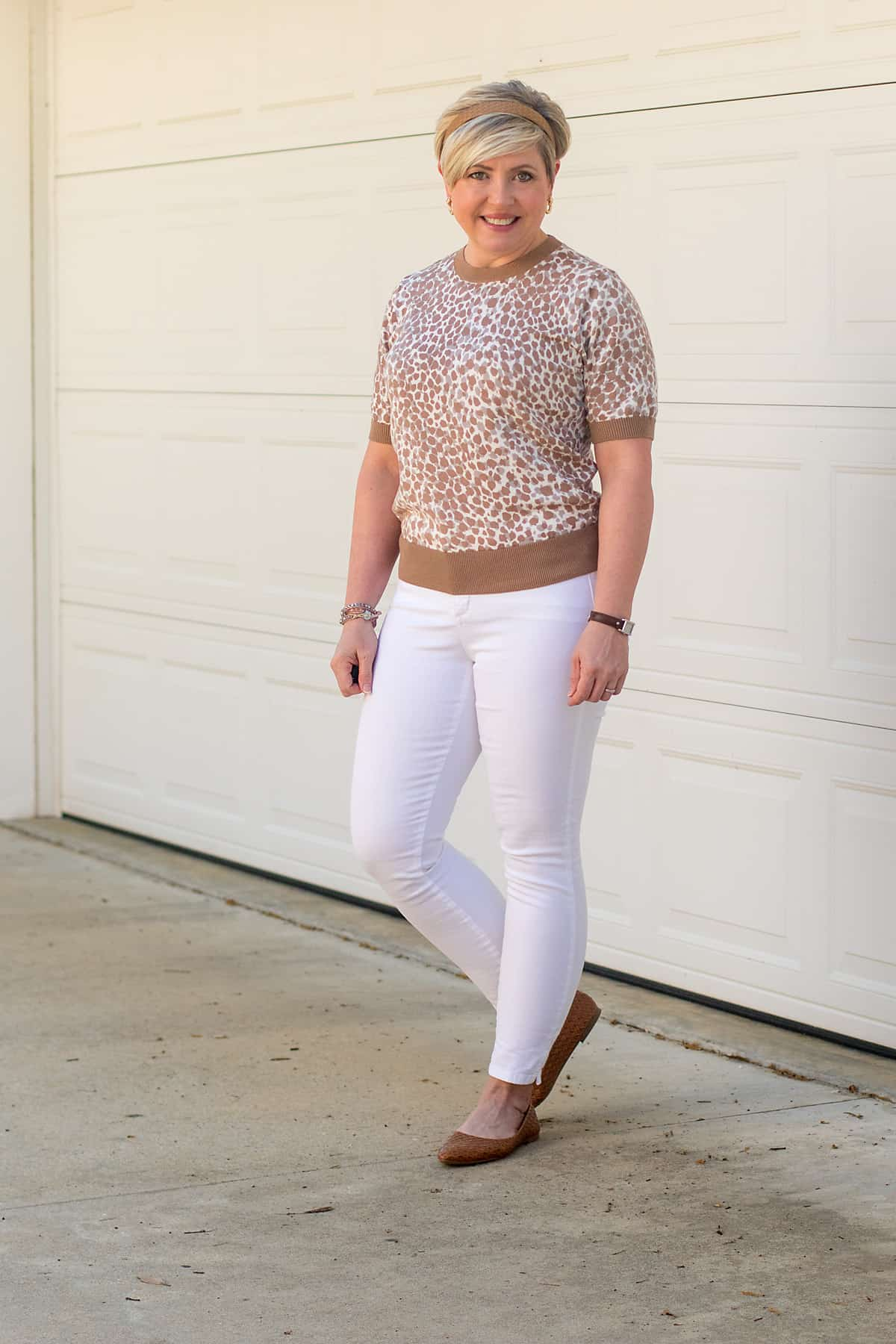 women's spring neutrals outfit with leopard sweater and white jeans