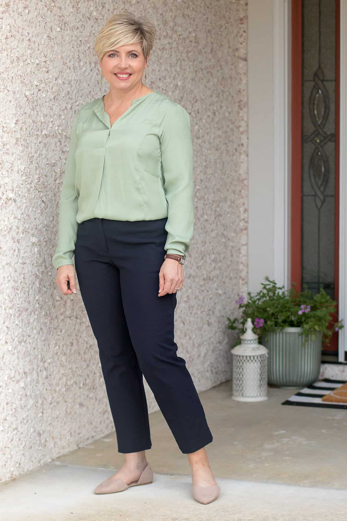 womens work wear outfit with navy ankle pants, green ash popover and taupe flats