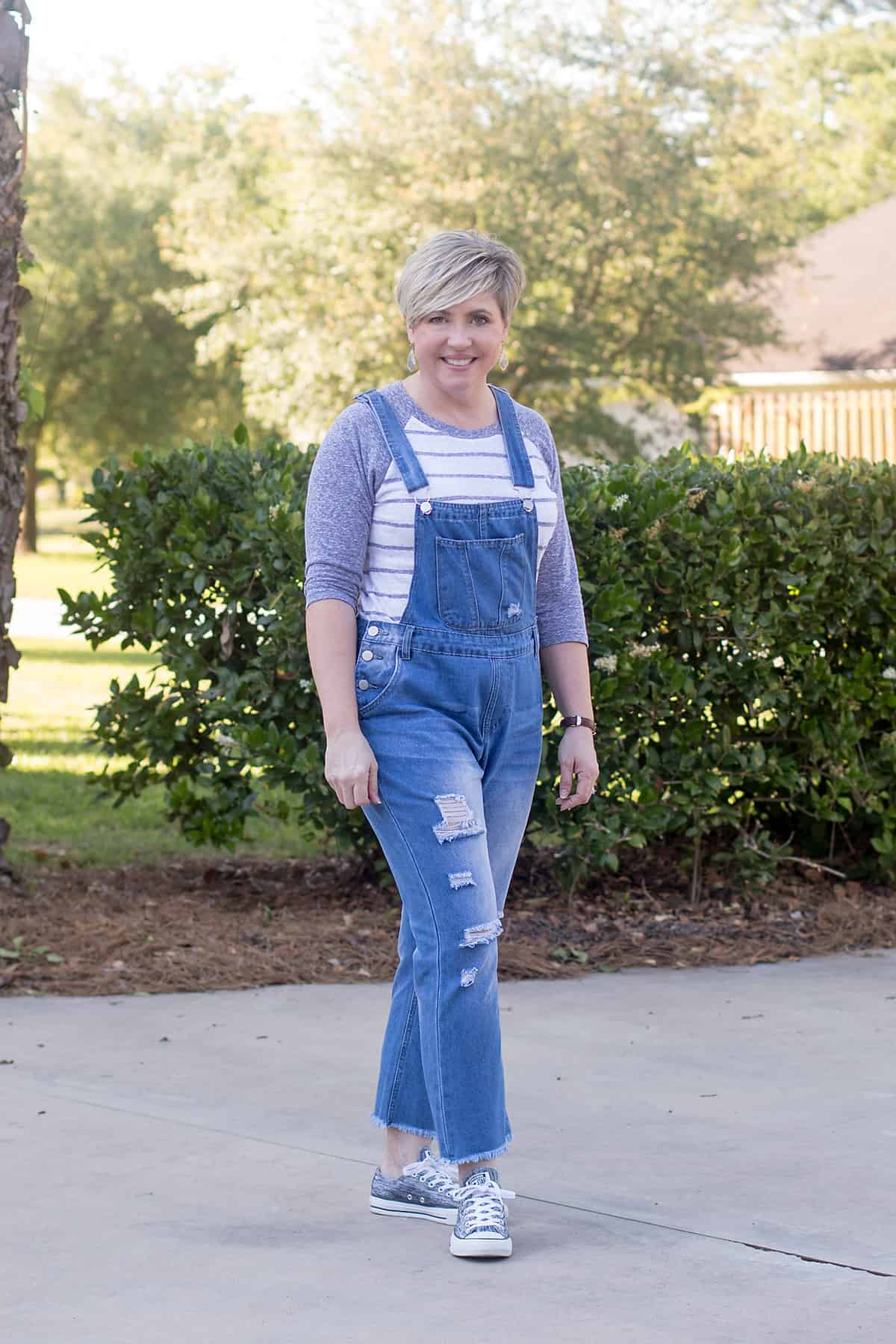 distressed overalls and sneakers outfit