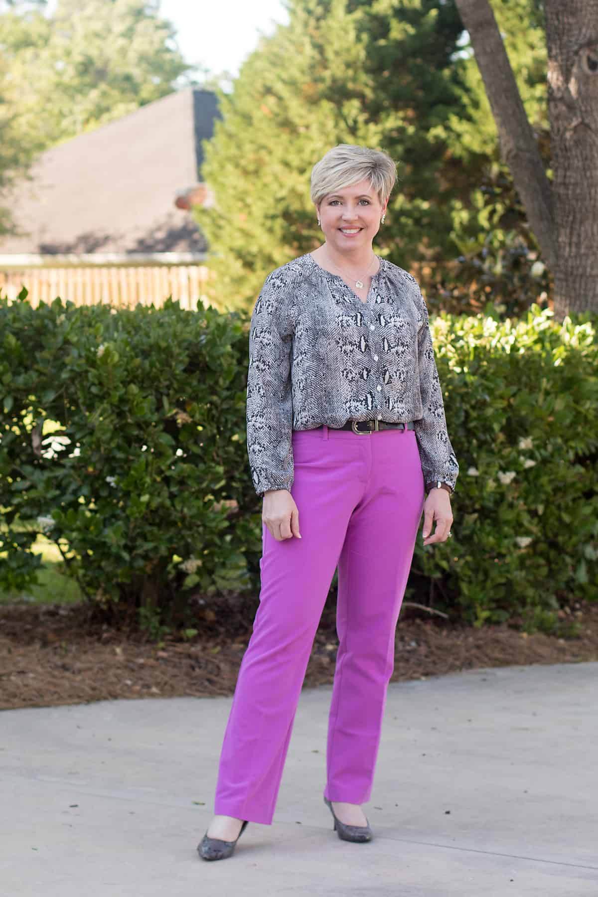 women's business casual look with amethyst orchid pants and snakeskin blouse