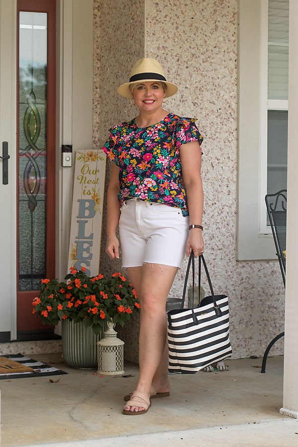 womens summer outfit with floral top and white shorts