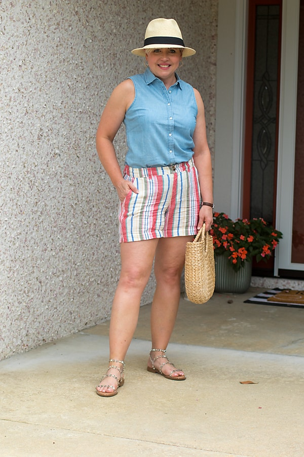 womens summer outfit with straw hat and striped shorts