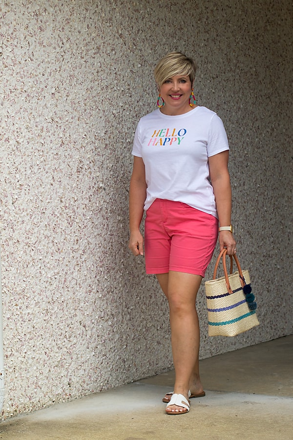 striped straw bag with colorful summer outfit