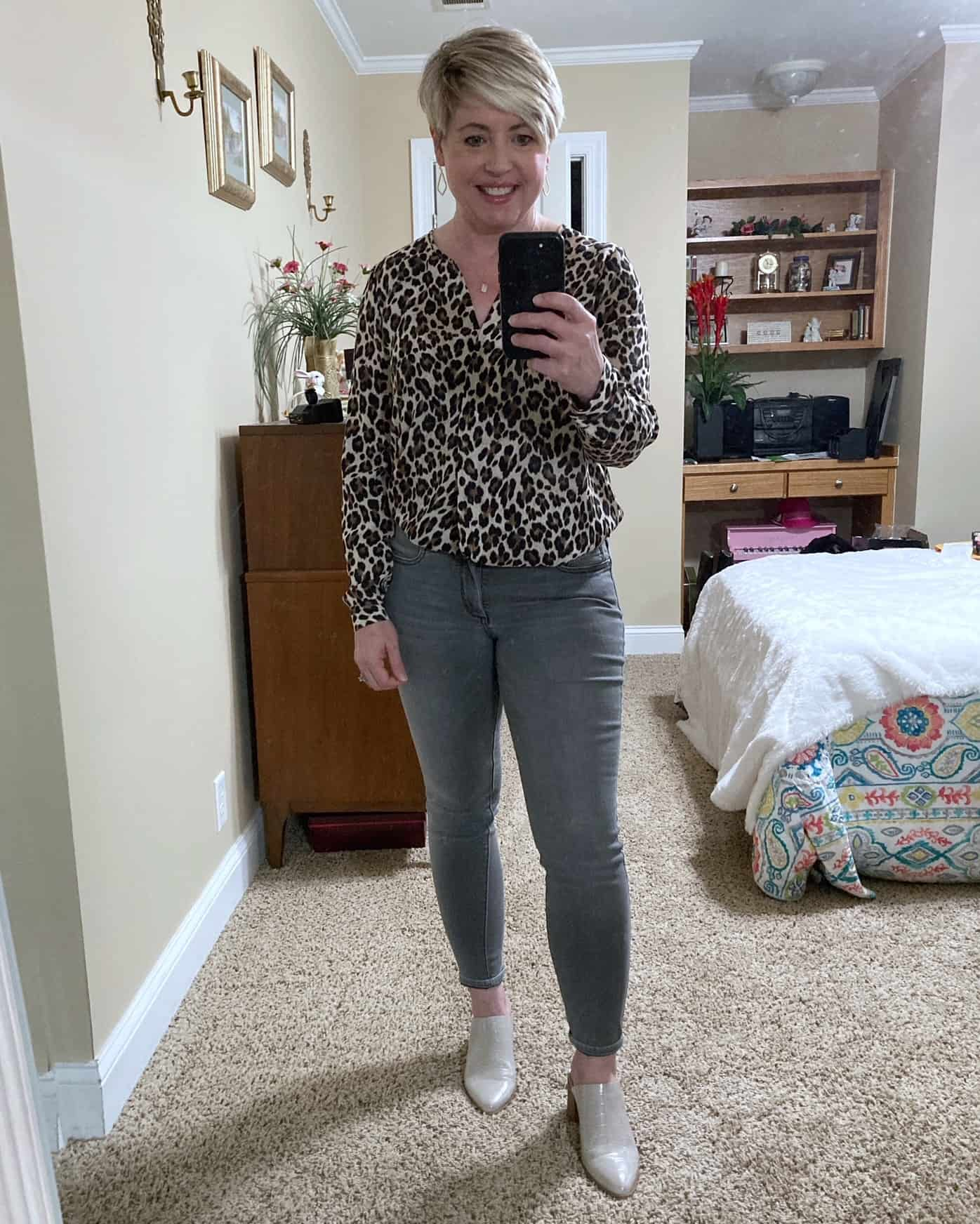 leopard print top with grey jeans